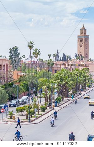 MARRAKESH, MOROCCO, APRIL 3, 2015: Busy Houmman el Fetouaki street and Mosque of El Mansour