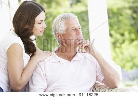 Adult Daughter Comforting Worried Father