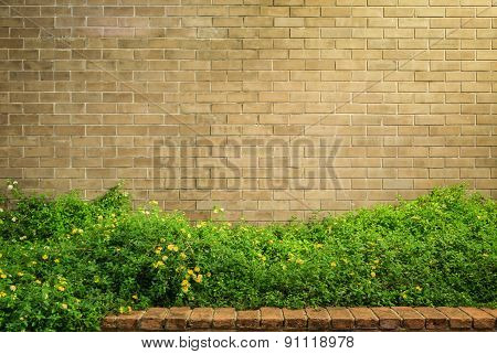 Decorative Brown Brick Wall With Grass