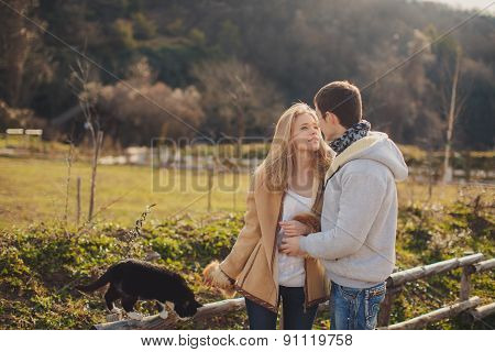 Loving young couple in autumn in the village.