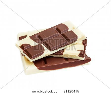 A stack of various roughly broken chocolate bars ranging from white to dark, isolated on white.