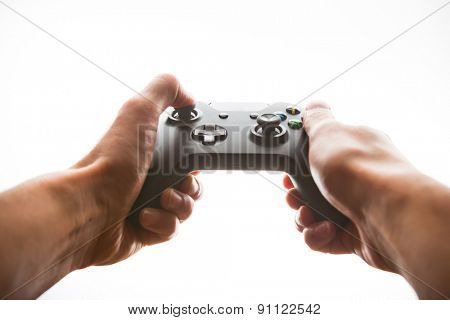 hands playing joystick, white light background