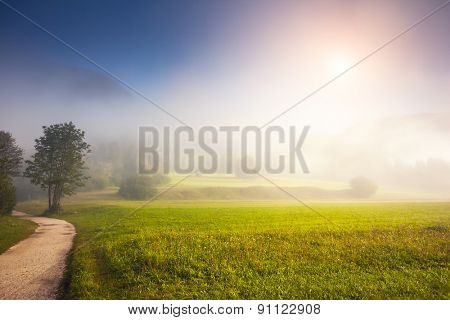 Fantastic panorama of foggy valleys in the Triglav national park. Located in the Bohinj Valley of the Julian Alps. Sky glowing by sunlight. Dramatic unusual scene. Slovenia, Europe. Beauty world.