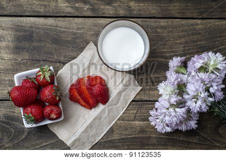 Fresh Ripe Strawberry In Bowl And Milk Over Wooden Table Background.