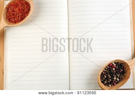 Spices with recipe book, closeup