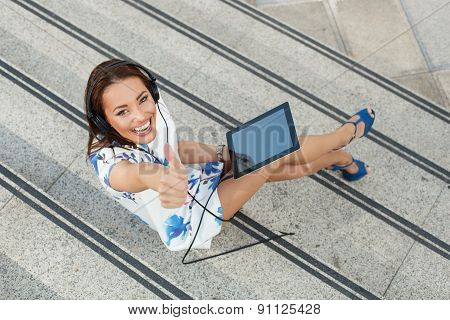 Attractive Women Listen To Music Via A Digital Tablet