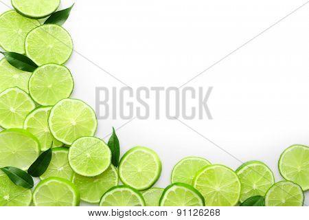 Frame of sliced fresh limes isolated on white