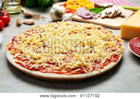 Raw pizza on table close up