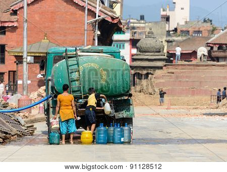 KATHMANDU, NEPAL - MAY 14, 2015: At Durbar Square a truck brings water to people forced to live in tents after two earthquakes hit Nepal.
