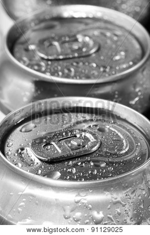Two Beer Cans With Water Drops