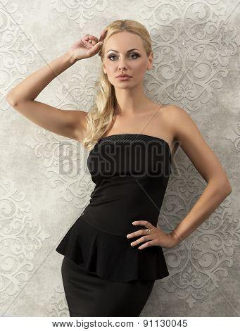 Blond Elegant Woman Near Fashion Wall