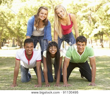 Group Of Teenage Friends Having Fun In Park