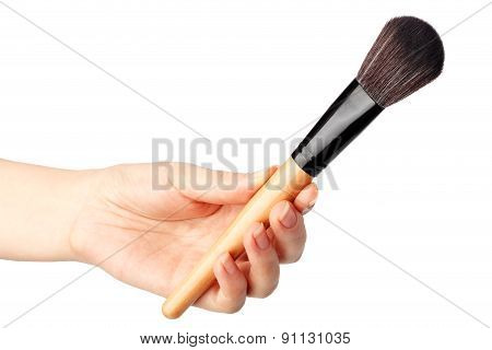Makeup brush in hand