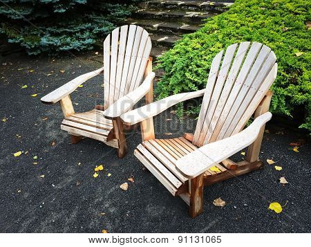 Wooden Chairs In Autumn Garden