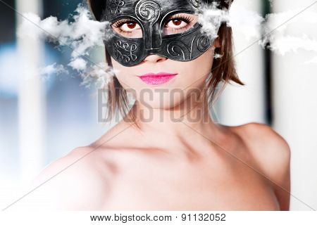 portrait of beautiful young woman with carnival mask on Cloud Background.