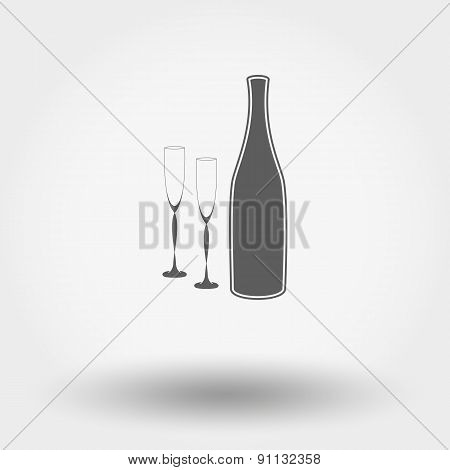 Bottle with wine glasses.