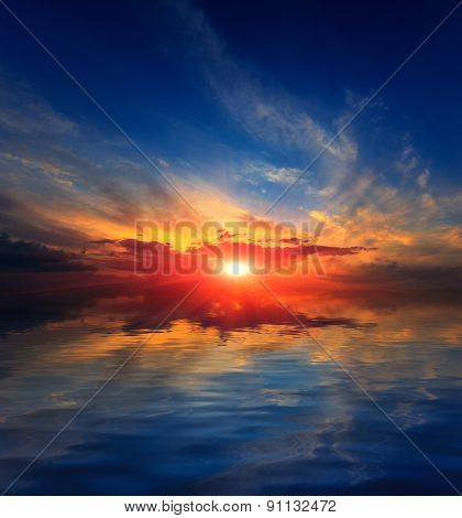 Nice sunset sky over water of lake