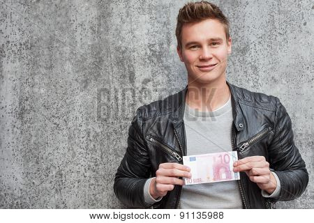 Casual young guy holding 10 euro