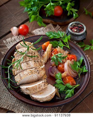 healthy dinner - healthy baked chicken breast with vegetables on a ceramic plate in a rustic style.