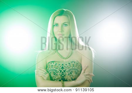 Beautiful Young Woman Between White And Green Lights