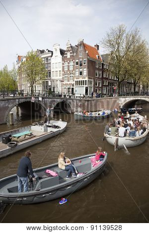 Many People On Canal Trip In Centre Of Dutch Capital Amsterdam
