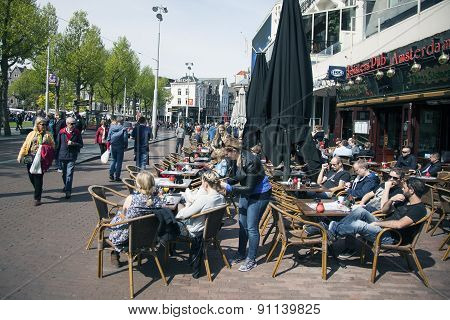 People In Amsterdam Enjoy Sunny Day On Rembrandtplein
