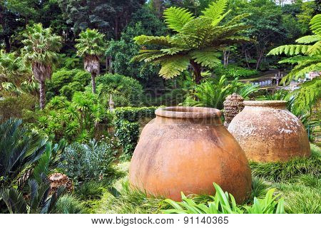 Large ceramic barrel in a tropical park.