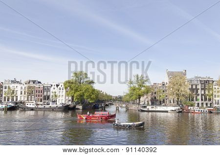 Boats On River Amstel In Amsterdam