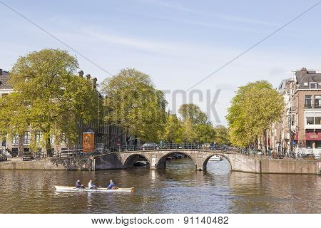 Amstel And Herengracht On A Sunny Spring Morning In Amsterdam