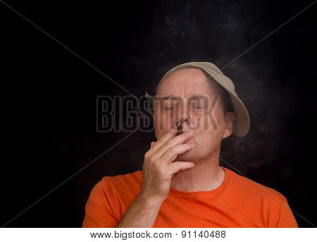 Mature man inhaling cigar