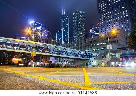 Traffic light trails in illuminated city
