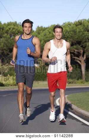 Two Men Running On Road