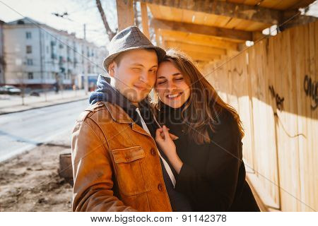 Portrait Of A Beautiful Couple Walking In The Street In Summer, They Wear  Hat