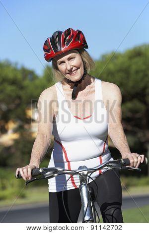Senior Woman On Cycle Ride