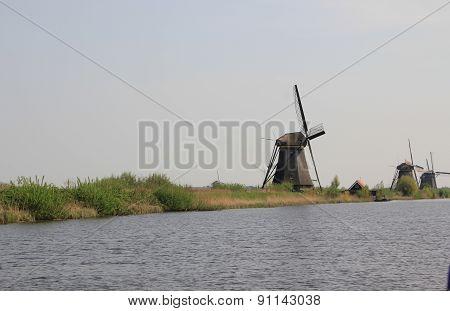 Dutch Landscape With Windmills.