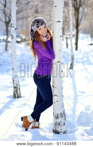 Beautiful Brunette Standing Near Birch In Winter