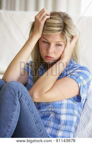 Portrait Of Depressed Young Woman At Home