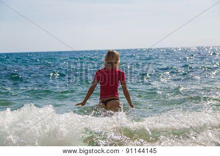 Sexy Girl In Sportwear And Tanga In Water