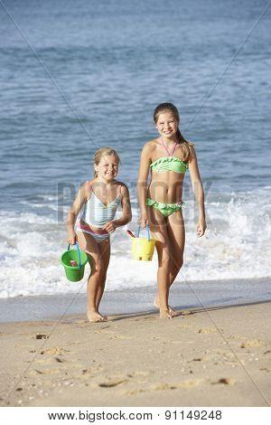 Two Young Girls Enjoying Beach Holiday
