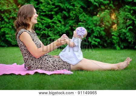 Beautiful Mother And Baby Outdoors. Nature. Beauty Mum And Her Child Playing In Park Together. Outdo