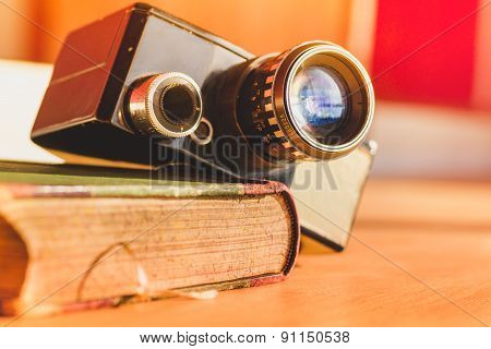 old video camera and an antique book