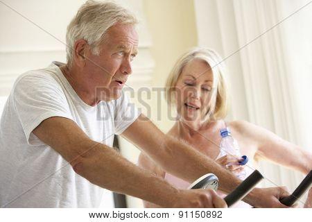 Senior Couple On Exercise Bike