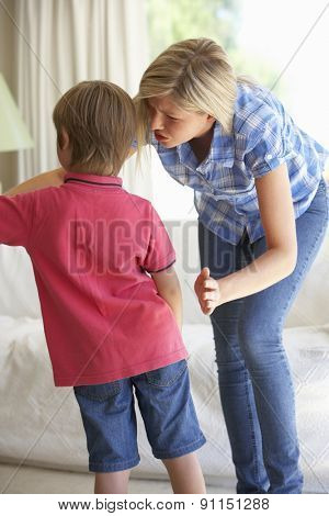 Mother Telling Off Son At Home