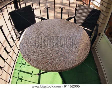 Round Empty Table In Marble And Two Chairs