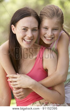 Mother And Daughter Relaxing In Countryside