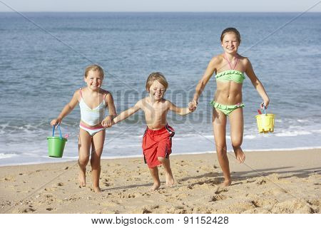 Group Of Children Enjoying Beach Holiday