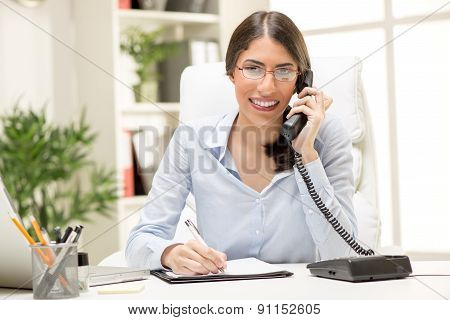 Beautiful Businesswoman Phoning In The Office