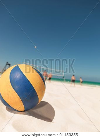 Yellow and blue volley ball on the beach.