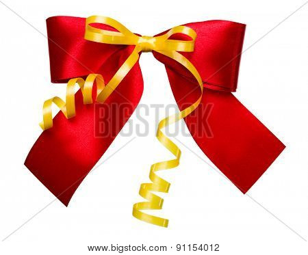 red bow with golden ribbon made from silk isolated