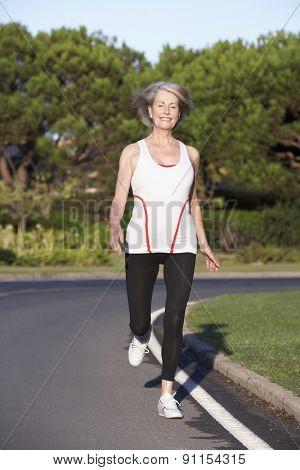 Senior Woman Running On Road